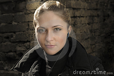 Young beautiful girl with earbud.
