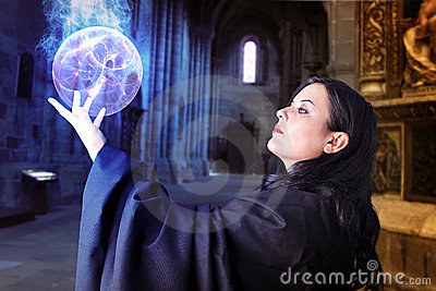 Young beautiful girl with energy sphere