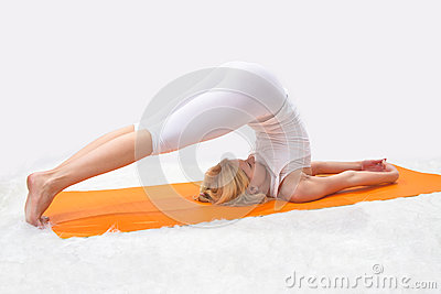 Young beautiful girl is  engaged in yoga