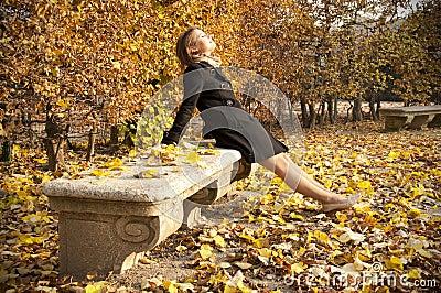 Young beautiful girl enjoying warm autumn sun