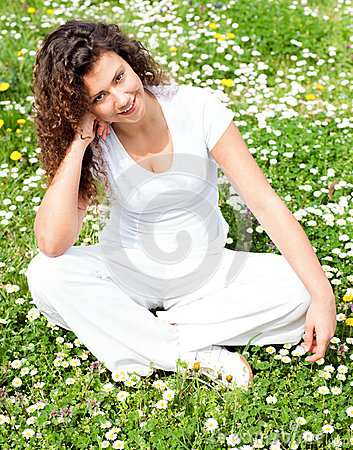 Young beautiful girl in flower field