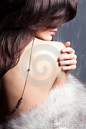 Young beautiful girl in a fur collar