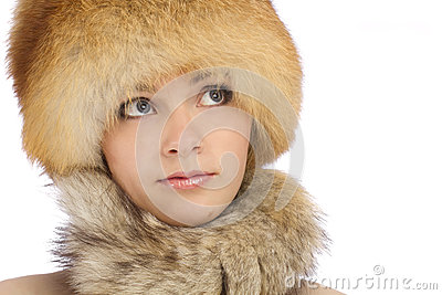 Young beautiful girl in fur hat
