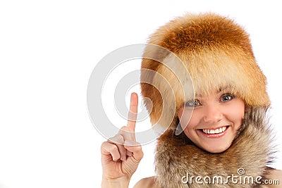 Young beautiful girl in fur hat