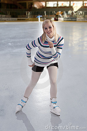 Young beautiful girl ice skating