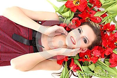 Young beautiful girl lying on the tulips