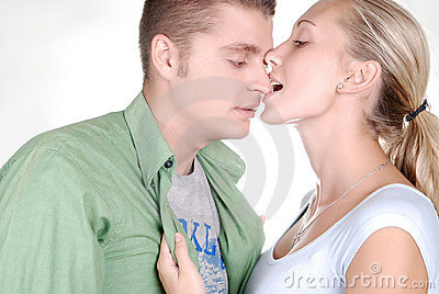Young beautiful girl nibbling her boyfriend