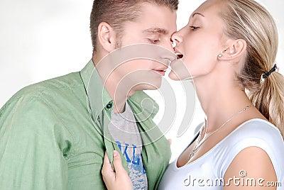 Young beautiful girl nibbling her boyfriend