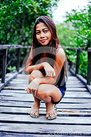 Free Young Beautiful Girl Portrait On The Wooden Bridge In The Mangrove Forest Royalty Free Stock Images - 94574309
