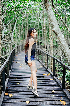Free Young Beautiful Girl Portrait On The Wooden Bridge In The Mangrove Forest Stock Images - 94574364