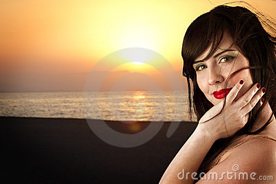 Young beautiful girl posing on beach