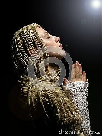 Young and beautiful girl praying 2