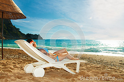 Young beautiful girl relaxing on beach