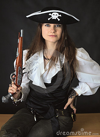Young beautiful girl - sea pirate with pistol
