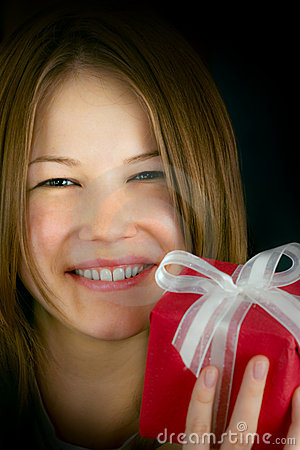 Young beautiful girl with a small gift box