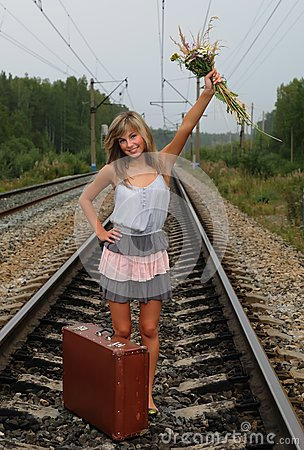 The young beautiful girl at a station