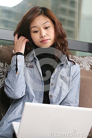 Young beautiful girl use pc