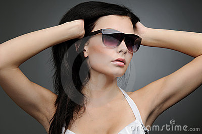 Young beautiful girl in wayfarer style glasses