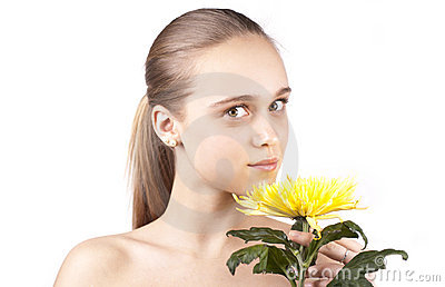 Young beautiful girl with yellow flower