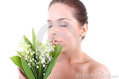 Young beautiful healthy woman with flowers