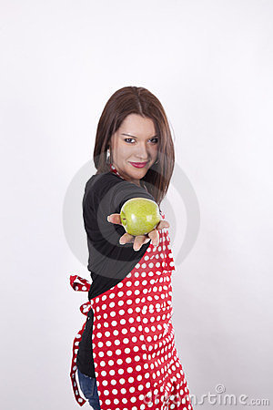 Young beautiful housewife holding apple