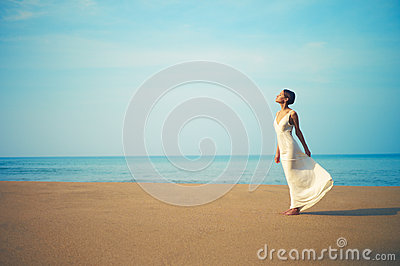 Young beautiful lady on the beach