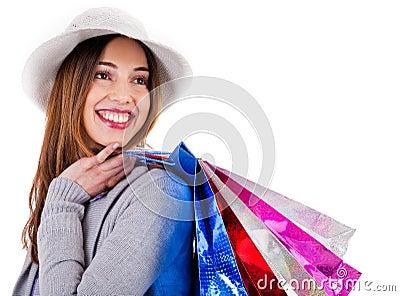 Young beautiful model carrying her shopping bags