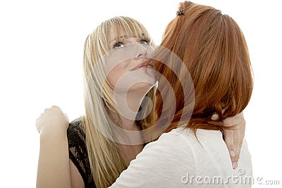 Young beautiful red and blond haired girls kiss