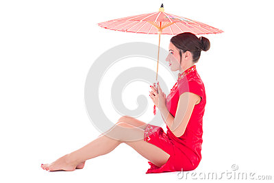 Young beautiful sitting woman in red japanese dress with umbrell