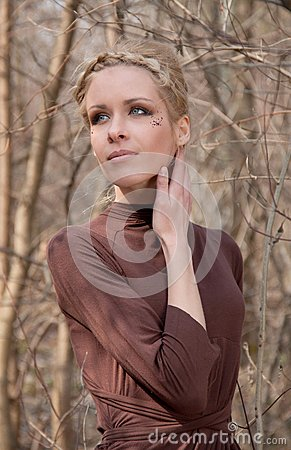 Young beautiful slim girl in the reed