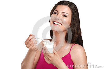 Young beautiful smiling woman eating fresh yogurt