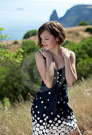 Young beautiful smiling woman outdoors Stock Photo