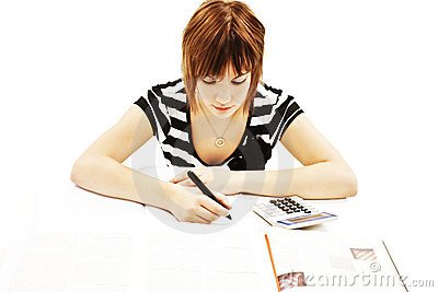 Young and beautiful student girl at the desk