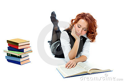 Young beautiful student girl read book