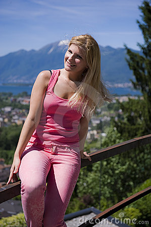 Young beautiful summer woman outdoors. mountains