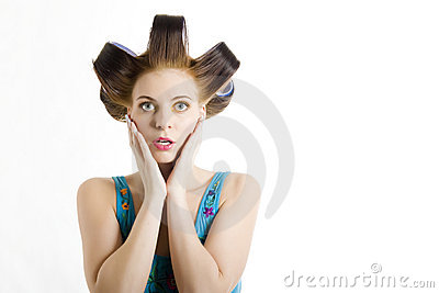Young beautiful surprized woman with hair curlers