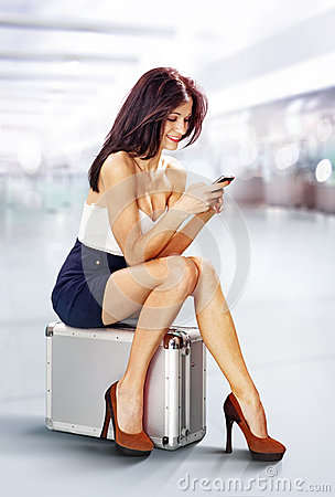 Traveler in airport with phone