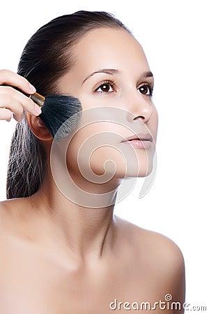 Young beautiful woman apply natural makeup