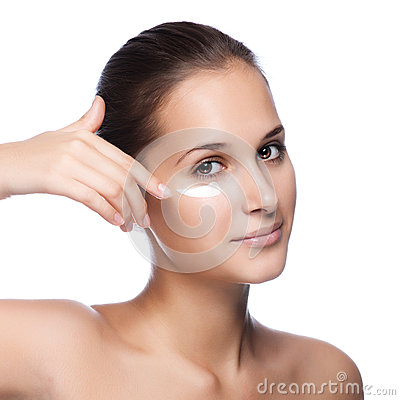 Young beautiful woman applying moisturize cream