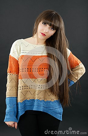 A young beautiful woman with bangs in studio