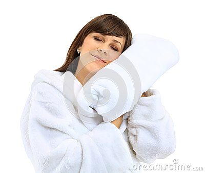 Young beautiful woman in bathrobe with towel