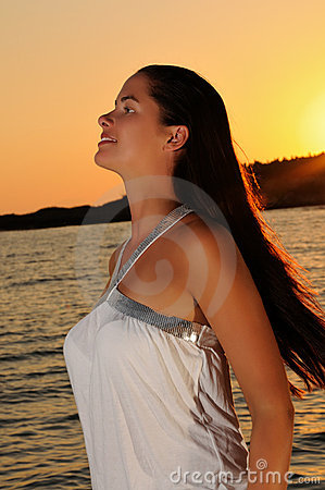 Young beautiful woman at the beach