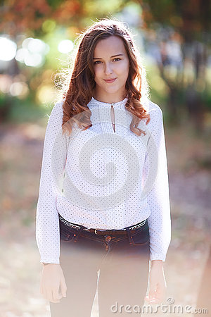 Free Young Beautiful Woman. Beauty Smiling Teenager Girl In Autumn Park Royalty Free Stock Photos - 78830848