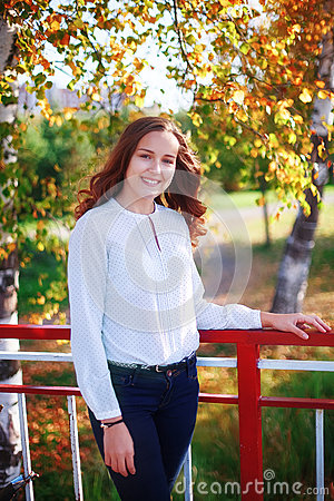 Free Young Beautiful Woman. Beauty Smiling Teenager Girl In Autumn Park Royalty Free Stock Photos - 78831168