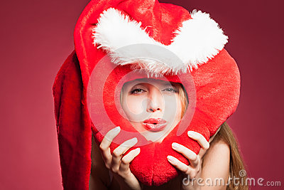 Young beautiful woman with big red heart