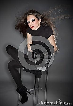 Young beautiful woman in black combi dress