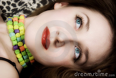 Young beautiful woman with blue eyes and red lips