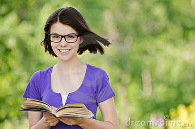 Young beautiful woman with book