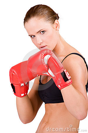 Young beautiful woman in boxing gloves