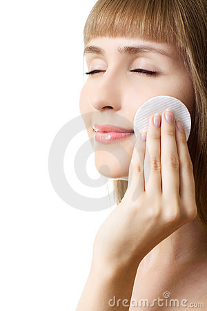 Young beautiful woman cotton swab cleaning face